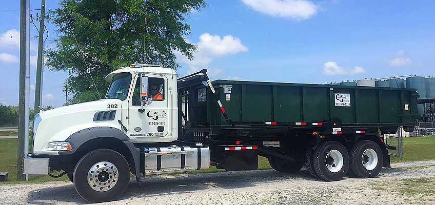 Cumberland Services roll-off truck leaving facility