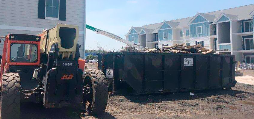 Cumberland Services roll-off container on subdivision construction site.