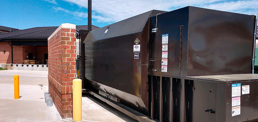 Cumberland Services stationary compactor on site.