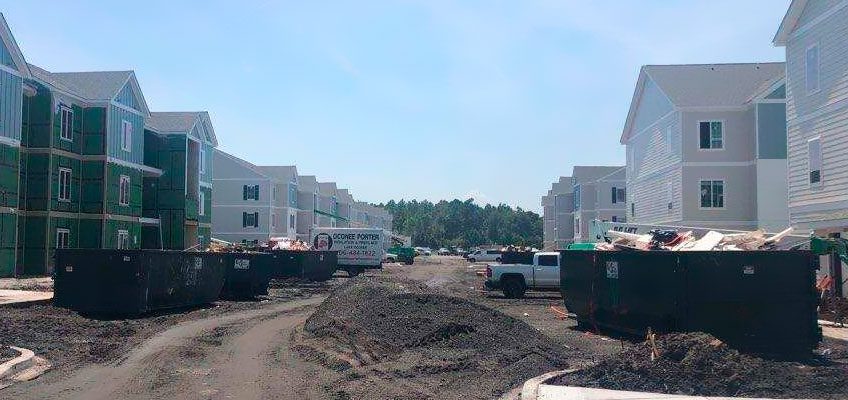 Multiple Cumberland Services roll-off containers on subdivision construction site.