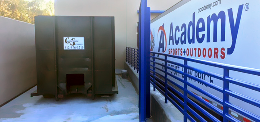 Cumberland Services Compactor service for Academy Sports sporting goods.